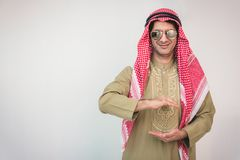 Arab businessman outstretched hand for implementation. Concept business Royalty Free Stock Image