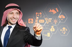 The arab businessman pressing virtual buttons. Arab businessman pressing virtual buttons Royalty Free Stock Photo