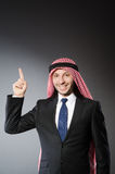 Arab businessman pressing virtual buttons Stock Photo
