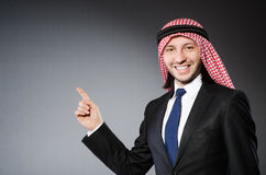 Arab businessman pressing virtual buttons Stock Image
