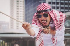 Arab businessman Pull the rope. Man Stock Photos
