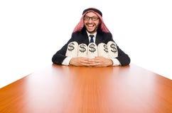 Arab businessman with sacks of money Stock Image