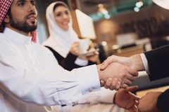 Arab businessman shakes hands with partner. stock photos