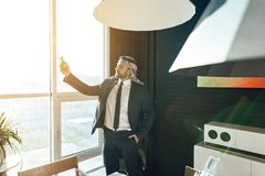 Arab businessman standing at window with model airplane. Royalty Free Stock Photos