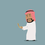 Arab businessman stepping onto compass to success. Business navigation, direction, way to success theme design. Smiling cartoon arab businessman is looking at Royalty Free Stock Photo