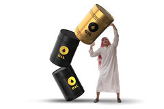 The arab businessman supporting oil barrel Royalty Free Stock Photos