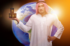 The arab businessman supporting oil price. Arab businessman supporting oil price Stock Image
