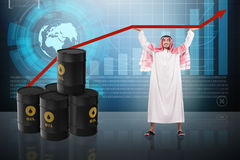 The arab businessman supporting oil price Royalty Free Stock Image
