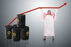 The arab businessman supporting oil price Royalty Free Stock Images