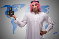 The arab businessman supporting oil price Stock Photo