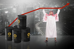 The arab businessman supporting oil price Stock Photos