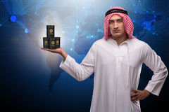 The arab businessman supporting oil price Royalty Free Stock Photography
