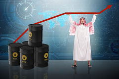 The arab businessman supporting oil price. Arab businessman supporting oil price Stock Photos