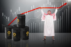 The arab businessman supporting oil price Stock Photography