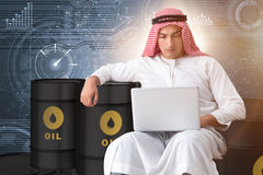 The arab businessman trading crude oil on laptop Stock Images