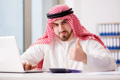 The arab businessman working on laptop computer. Arab businessman working on laptop computer Stock Images