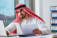 The arab businessman working on laptop computer Stock Photography