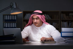 The arab businessman working late in office Royalty Free Stock Image
