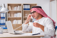 The arab businessman working in the office Stock Photo