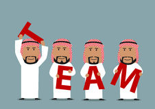 Arab businessmen creating a word Team Stock Image