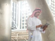 Arab businessmen use tablets while in business stock images