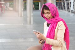 Arab businesswoman messaging on a mobile phone. In the city Royalty Free Stock Photography