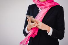 Arab businesswoman messaging on a mobile phone. Woman Royalty Free Stock Image