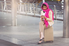 Arab businesswoman messaging on a mobile phone. In the city Royalty Free Stock Images