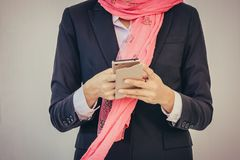 Arab businesswoman messaging on a mobile phone. Woman Stock Images