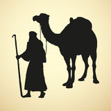 Arab with camel laden. Vector drawing Stock Photography