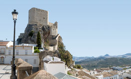 Arab Castle tower of Olvera. Arab Castle tower located in Olvera Cadiz mountain range of this set in its houses and olive groves Stock Photography