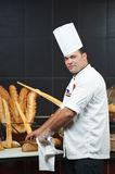 Arab chef cutting bread Royalty Free Stock Photos