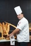 Arab chef cutting bread Royalty Free Stock Photos