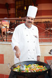 Arab chef frying meat on pan Stock Photo