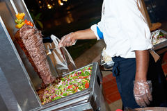 Arab chef making kebab Royalty Free Stock Images