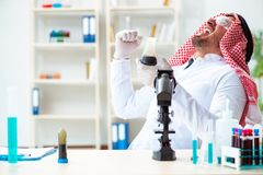 The arab chemist scientist testing quality of oil petrol. Arab chemist scientist testing quality of oil petrol royalty free stock images