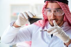 The arab chemist scientist testing quality of oil petrol. Arab chemist scientist testing quality of oil petrol stock images