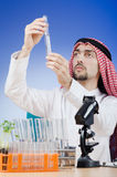Arab chemist working in lab Stock Photography