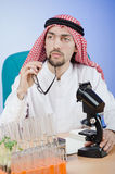 Arab chemist working in lab Royalty Free Stock Photo