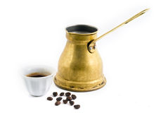 Arab coffee. Arab small copper coffee pot with cup and coffee beans isolated on white Royalty Free Stock Images