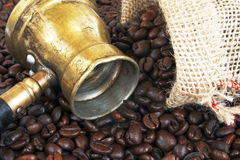 Arab copper coffee pot. Arab coffee pot and roasted coffee beans Royalty Free Stock Photo