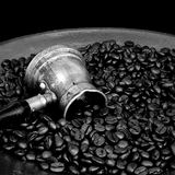 Arab copper coffee pot. Arab coffee pot and roasted coffee beans Stock Image