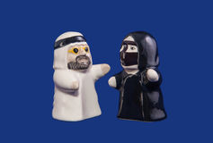Arab couple. The Arab figurines for salt and pepper in national suits Royalty Free Stock Images