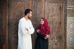 Arab couple in relationship talking and smiling. In traditional cloathing Royalty Free Stock Photography