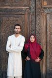 Arab couple in traditional clothing looking at camera. Arab couple in traditional cloths looking at camera Stock Image