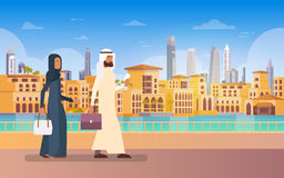 Arab Couple Walking Dubai, Modern Building Cityscape Skyline Panorama Business Travel And Tourism Concept Royalty Free Stock Image