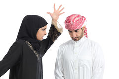 Arab couple with a woman arguing to her husband Stock Photography
