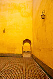 Arab courtyard. Arabic typical entry on a yellow wall Stock Images