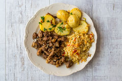 Arab Cuisine Lamb Meat, Bulgur and baked slice potatoes. Royalty Free Stock Photos