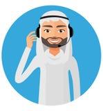 Arab customer service call center operator in  headset on duty. Stock Photo